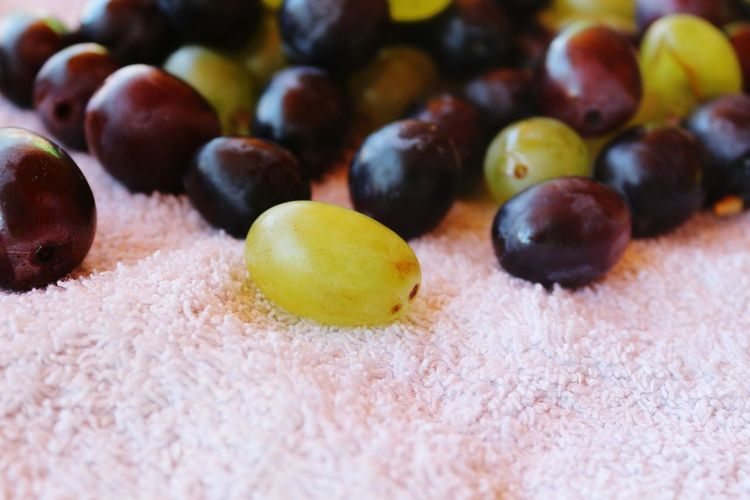 Close-up of grapes on fabric