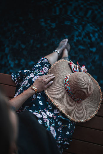 Women One Person Adult Clothing Real People Lifestyles Human Body Part Human Hand Leisure Activity Hand High Angle View Selective Focus Day Sitting Hat Relaxation Outdoors Body Part Holding Human Limb