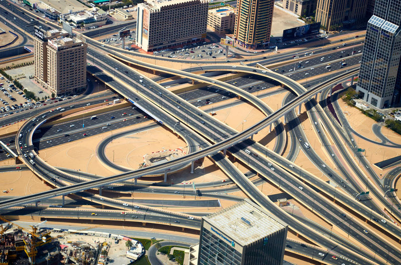Motorway junction in Dubai Aerial View Architecture Bridge - Man Made Structure City City Life Cityscape Connection Day Direction Downtown District High Angle View Highway Junction Modern Motorway No People Outdoors Road Road Intersection Skyscraper Transportation Travel Destinations Urban Skyline Ways