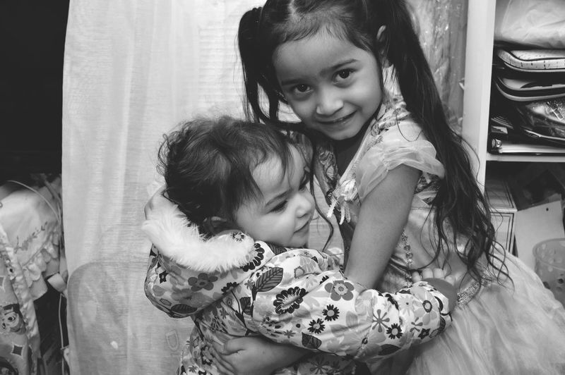 Littlesister BigSister Kids Family Sisters Hug Childhood Togetherness Real People Girls Two People Bonding Lifestyles Love Indoors  Smiling Cute Happiness Looking At Camera