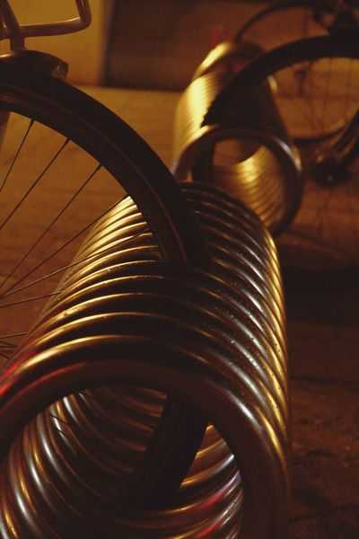 No People Close-up Indoors  Day Bicycle Rack Golden Shimmer Silhouette Bicycle Spiral EyeEm Best Shots EyeEmBestPics Wijnegemshoppingcenter Urbanphotography Streetphotography