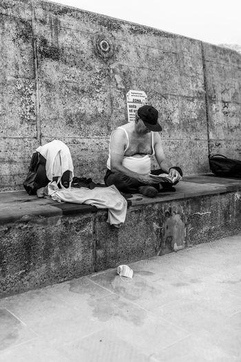 Men sitting on wall