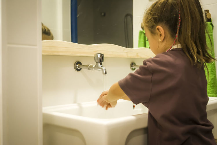 Child Child Autonomy Cleaning Domestic Life Girl Growing Hand Washing One Person Real People Self Caring Washing Water