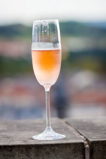 Close-Up Of Champagne Flute On Retaining Wall