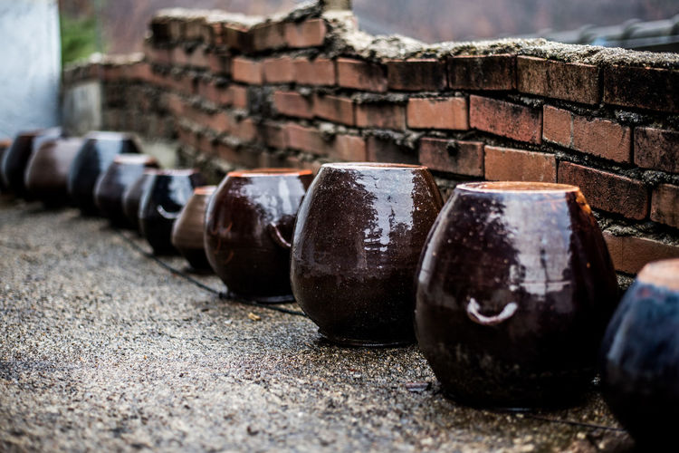 Close-up of abandoned objects against wall