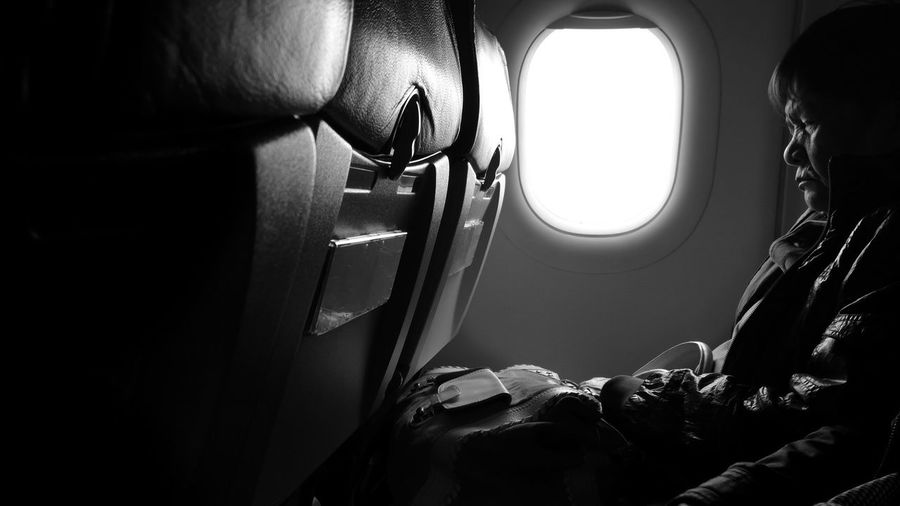 Senior Man Sitting In Airplane