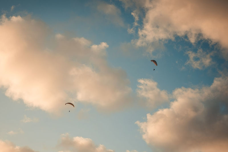 chasing sunset Go Higher Cloud - Sky Sky Flying Adventure Nature Mid-air Transportation Extreme Sports Sport Leisure Activity Parachute Low Angle View Paragliding