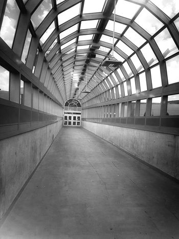 Go forward. Indoors  The Way Forward Architecture Leading Lines Architecture Arch Architectural Feature Design Entryway Entrance Walkway My Point Of View My Town Mississauga. Ceiling Black And White Black And White Photography The Week On EyeEm Black And White Friday Colour Your Horizn