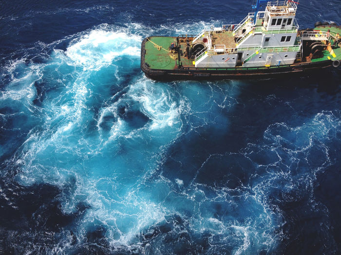 Above Beauty In Nature Boat Caribbean Cruise Day Island Motion Nature Nautical Vessel No People Ocean Outdoors Room For Text Sea Ship Sky Tug Tugboat Vessel Water Waves