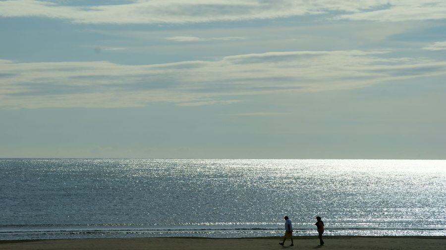 The Essence Of Summer Couple Walking at La Pineda Beach , SPAIN . Sony A350 Beach Photography Sea And Sky Enjoying Life Tourism Tourist Attraction  Minimalism Silhouette Silhouettes Summer Summertime Showcase June Walk Catalunya