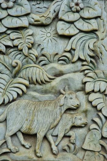 Indonesia, Bali, Ubud, Agung Rai Museum of Art - ARMA -, vertical reliefs of nature, goats Agung Rai Museum Architecture Arts And Crafts ASIA Bali, Indonesia Bas-relief Close-up Culture Day Goats INDONESIA Nature Motif No People Ubud, Bali Vertical