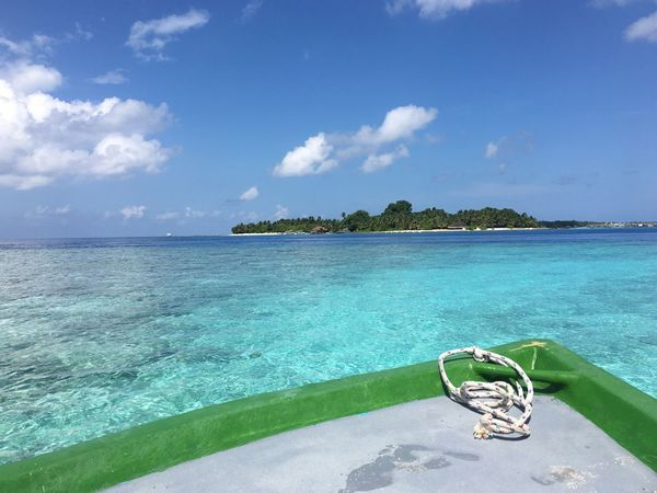 Maldives Islands Sea Blue Sky Water Beach Cloud - Sky Beauty In Nature Tranquil Scene Scenics Tranquility Outdoors Rasdhoo Nature Day Luxury No People Vacations Horizon Over Water Tropical Climate Palm Tree Boat Island Hopping Island Island Travel Miles Away