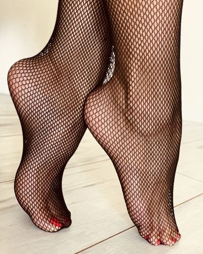 Low section of woman wearing stockings