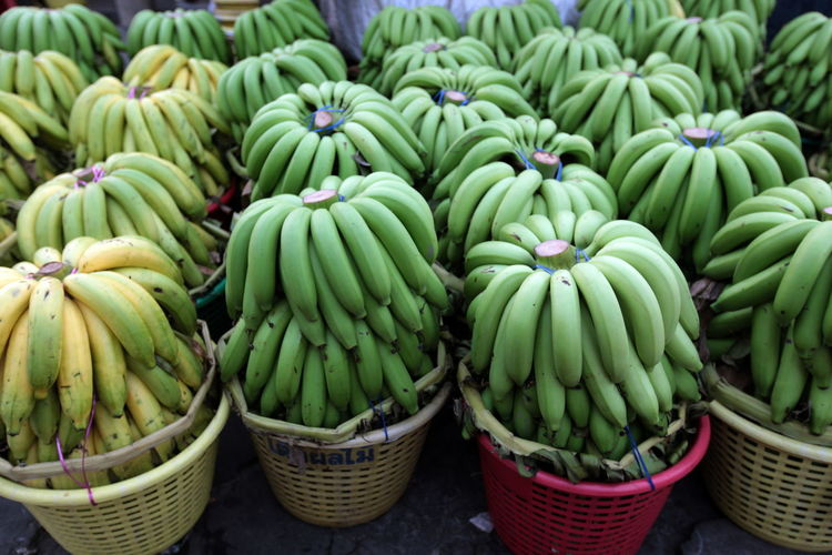 High angle view of bananas in baskets at market stall