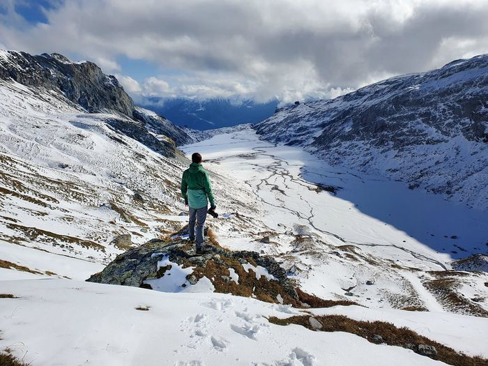 Photographer on mountain peak