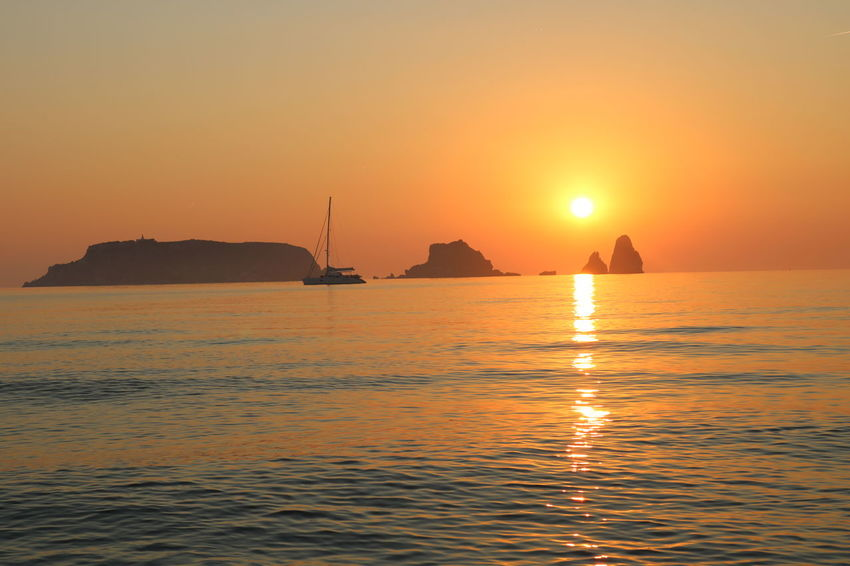 EyeEm Selects Sea Water Sky Sunset Beauty In Nature Sun Environment Scenics - Nature Nautical Vessel Tranquility Nature Land Travel Destinations Beach Sunlight Landscape Travel Transportation Seascape Outdoors
