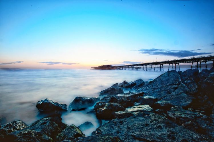 Long exposure and wet rocks. Sea Long Exposure Sea Nature Beauty In Nature Beach Sky Water Scenics Horizon Over Water Tranquil Scene Outdoors Sunset No People Blue Landscape