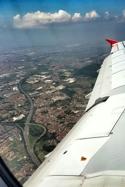 After take off Clouds And Sky Cityscapes From An Airplane Window Air Asia Bandung Toll Road Airbus Winglet
