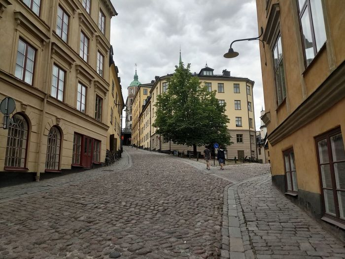 Street Outdoors Outdoor Photography Daylight Outdoor Photography Streetphotography Tourism Stockholm Sweden Travel Photography Sunlight City Architecture Sky Building Exterior Built Structure Cobblestone Old Town Townhouse TOWNSCAPE Alley Town Pavement Diminishing Perspective Empty Road The Way Forward Paving Stone Pathway Visiting Paved
