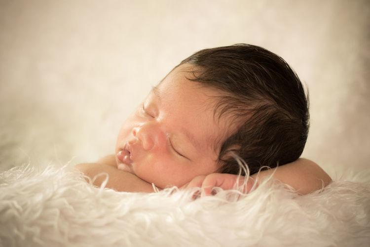 Cute Baby Boy Sleeping On Fur