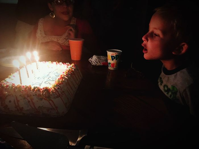 Food And Drink Drink Childhood Refreshment Holding Boys Birthday Cake Togetherness Birthday Birthday Party Birthday Boy People And Places Family Burning Elementary Age Flame Party - Social Event Freshness Enjoyment Indulgence Candlelight Person
