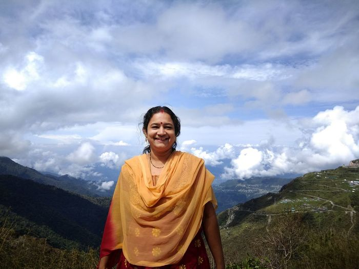 Only Women One Woman Only Cloud - Sky Mountain Adult Women One Person Smiling Happiness Portrait Looking At Camera Mountain Range Travelling Cheerful Travel Photography Sikkim@India EyeEmNewHere Second Acts Love Yourself Press For Progress The Portraitist - 2018 EyeEm Awards