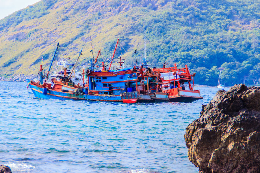 Colorful seascape with fisherman boat against deep blue sea in the ocean on the cloudy day at Phuket, Thailand. PromThepCape Promthep Cape Beauty In Nature Day Nature Nautical Vessel No People Outdoors Promthep Rock - Object Scenics Sea Sky Transportation Tree Water
