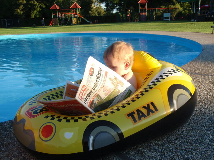 So sweet 🚣 funny picture 🌼Adventure Bezirks Journal Boy Capture The Moment Child Child Reads Childhood Children Only Day Happy Summer Newspaper One Boy Only Outdoors People Reading Real People Relaxing Moments Snapshot Summertime Sunlight Sweet Baby Swimmingpool Taxi Funny Picture Watertaxi