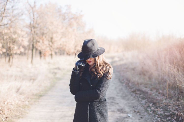 Portrait of a beautiful woman wearing hat Autumn Celebration Hat Winter Beautiful Woman Leisure Activity Lifestyles Nature One Person Real People Young Adult Young Women