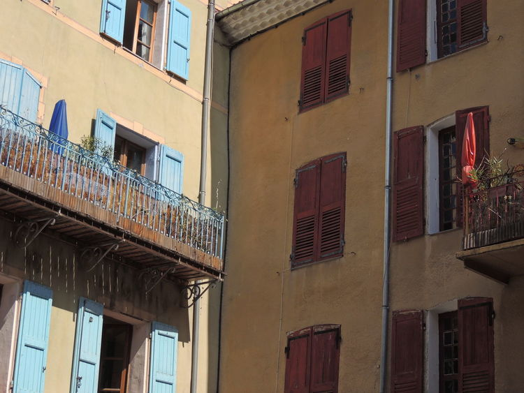 Apartment Architectural Feature Architecture Balcony Building Exterior Building Story Built Structure City City Life Day Exterior Façade Fire Escape In A Row Low Angle View No People Office Building Outdoors Provence Repetition Residential Building Residential Structure Sky Weathered Window