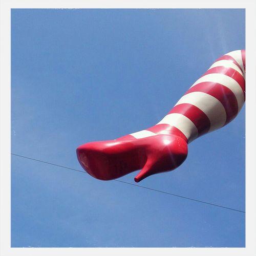 Upward View Of Plastic Figure Leg With High Heels Shoe
