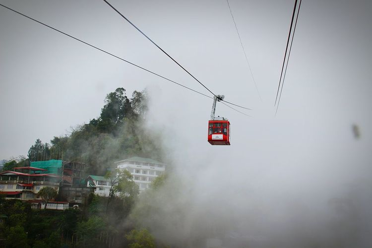 Overhead Cable Car Red Fog No People Mode Of Transport Ski Lift Sky Clouds And Sky Transportation Nature Viewfromthetop Amezing Peack Gangtok,India Houses On A Hill Break The Mold Neighborhood Map Live For The Story EyeEm Selects Shades Of Winter Go Higher Adventures In The City