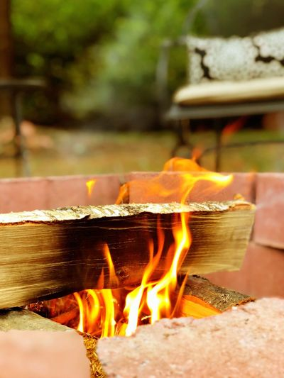 Close-up of burning fire on wood