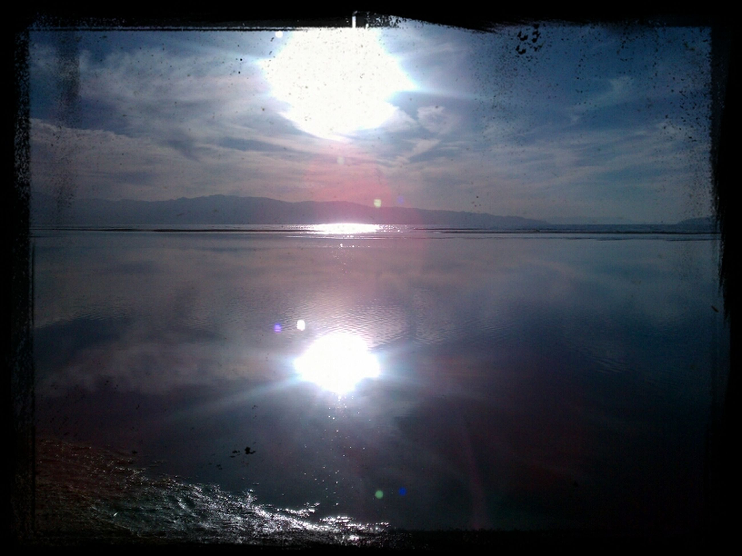 sun, transfer print, reflection, water, sunbeam, sky, tranquility, sunlight, tranquil scene, scenics, beauty in nature, sunset, lens flare, auto post production filter, nature, cloud - sky, idyllic, lake, bright, cloud