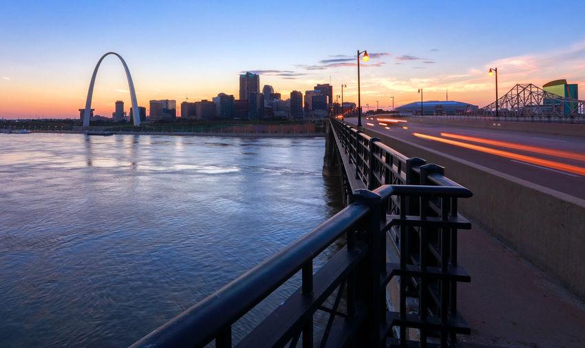 Bridge Over City Against Sky At Sunset