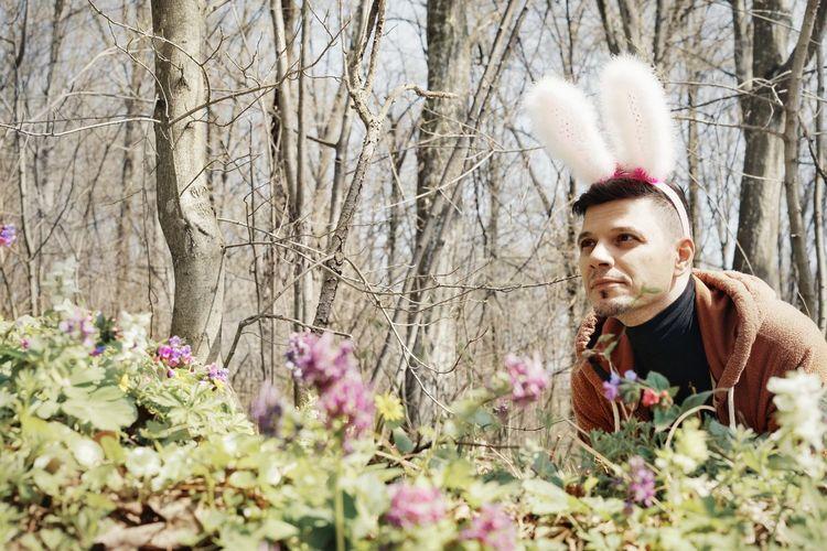 Young Man Wearing Bunny Ear Headband In Park