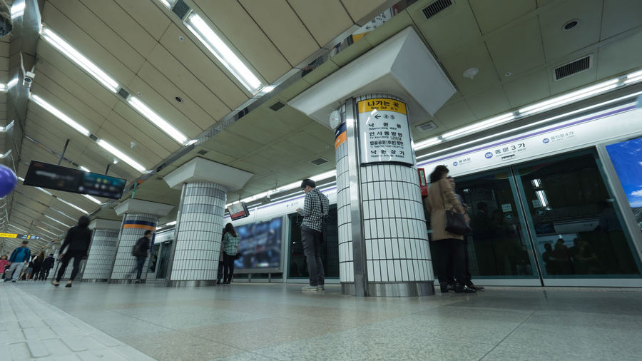 Low angle shot of people waiting for the train at subway station of Seoul, South Korea. Faces unidentified 4K Architecture ASIA Citu Commuter Horizontal Indoors  Metro Passenger People Person Public Seoul South Korea Stasion Subway Traffic Train Underground Urban Wait