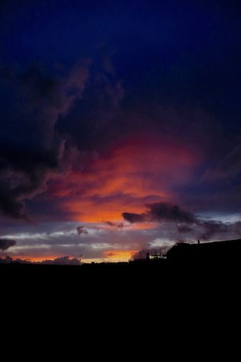 Silhouette landscape against scenic sky