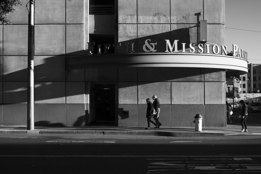 streets of san francisco California San Francisco Sidewalk Urban Lifestyle Wall Background Architecture Art Deco Architecture Building Exterior Building Facade Built Structure City Day Full Length Harsh Light Lifestyles Light And Shadow Outdoors Real People Standing Street Photography Strideby Transportation Walking Cinematic Black And White Friday