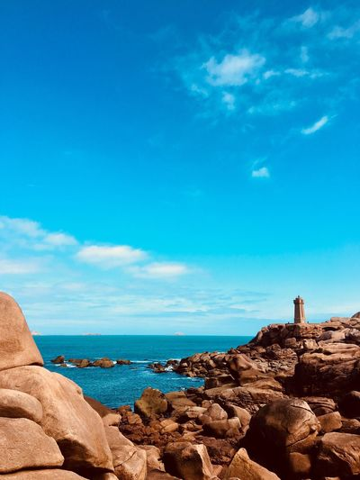 Lighthouse of Pink Granite coast Beauty In Nature Scenics - Nature Côte De Granite Rose Pink Granite Coast Travel Destinations Holiday Tourism Travel Seascape Landscape Land Idyllic Horizon Over Water Horizon Sea Waterfront Water Lighthouse Island Pink Color Rock Sunlight Sky And Clouds Blue Sky Rock Formation Nature Beach No People Day