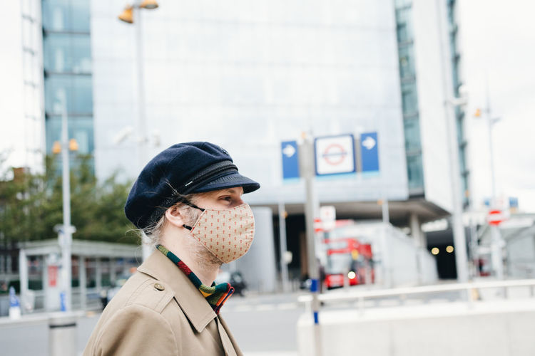 Portrait of man wearing a face mask man in city