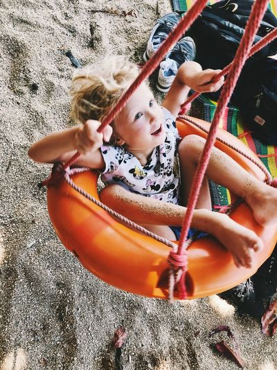 Childhood Child Girls Leisure Activity One Person Day Females Real People Lifestyles Playing Playground High Angle View Nature Women Innocence Full Length Fun Outdoors
