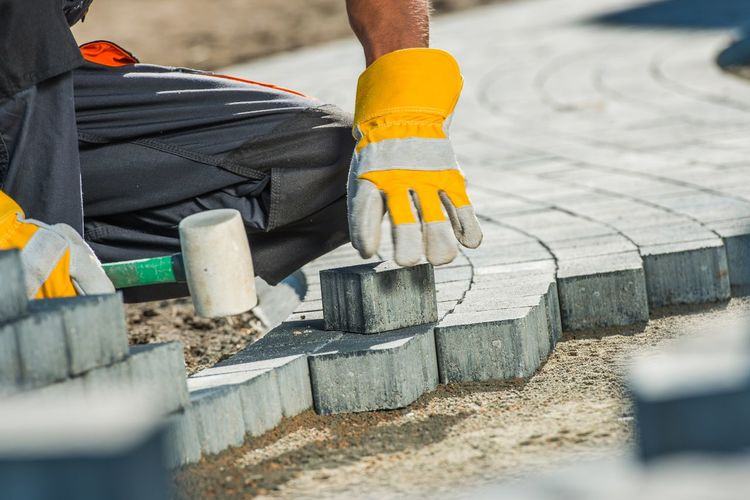 Midsection of manual worker working at construction site