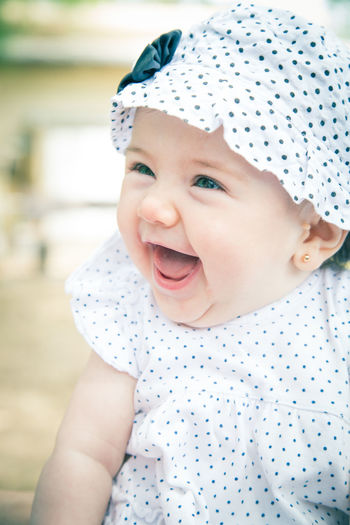Baby Babyhood Childhood Close-up Cute Day Focus On Foreground Happiness Indoors  Innocence Leisure Activity Lifestyles Looking At Camera One Person Portrait Real People Smiling Toddler  Visual Creativity