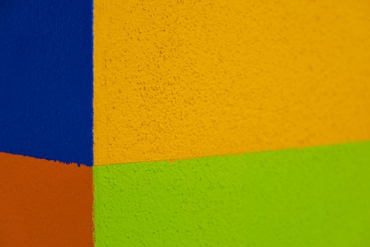 Abstract geometric pattern on concrete wall Art And Craft Equipment Backgrounds Blue Built Structure Choice Close-up Creativity Full Frame Geometric Shape Green Color Indoors  Multi Colored No People Orange Color Pattern Shape Textured  Variation Vibrant Color Wall - Building Feature Yellow