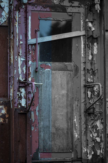 Abandoned Architecture Damaged Entrance Door Weathered Built Structure Old Deterioration Decline Building Exterior No People Run-down Metal Day Building Obsolete Rusty Bad Condition Outdoors Ruined