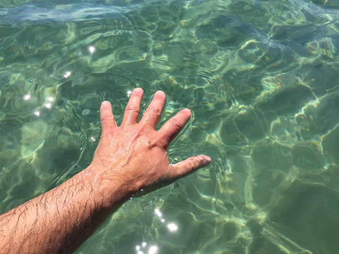 Close-up Day Hand High Angle View Human Body Part Human Hand Italian Man Nature One Person Outdoors People Real People Rippled Sea Swimming Pool Water Water Reflections