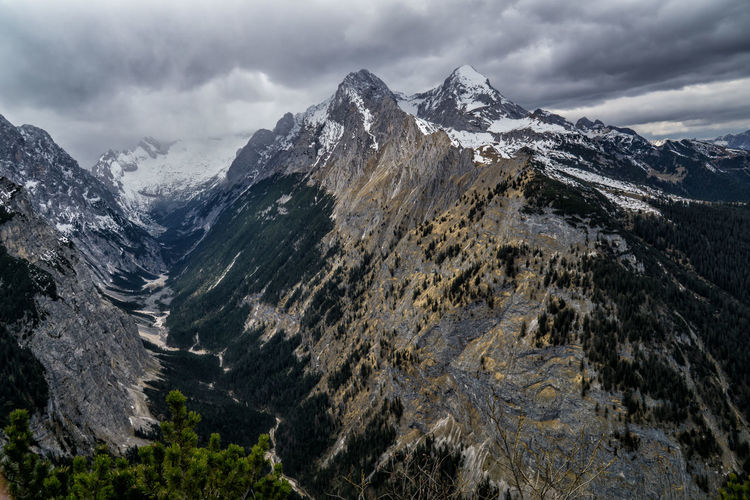 Stormy weather in spring Mountain Cloud - Sky Environment Mountain Range Scenics - Nature Sky Landscape Beauty In Nature Nature Mountain Peak Outdoors Day No People Wilderness Rock Snow Land Valley Storm Snowcapped Mountain Formation High Alps Bavaria