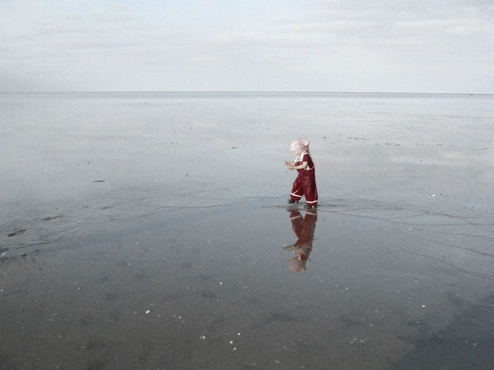 Side view of a girl with reflection on beach