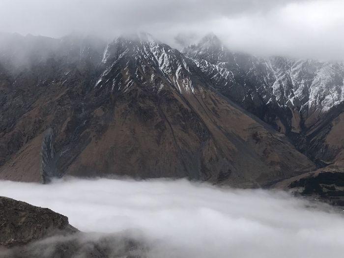 Cloudy day in mountains #Georgia #Mountains #Nature  #clouds  #cloudy #snow #top Cloudy Georgia Kazbegi Mountains Clouds Kazbegi Mountains Snow First Eyeem Photo